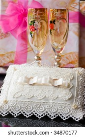 gold wedding rings on the white cushion