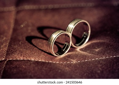 Gold wedding rings with precious stones