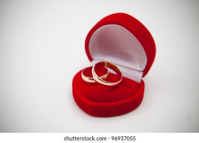 Gold wedding rings in a red box