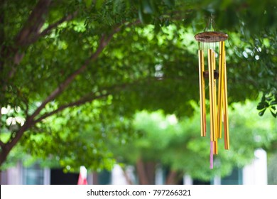 Gold wind bell under the tree