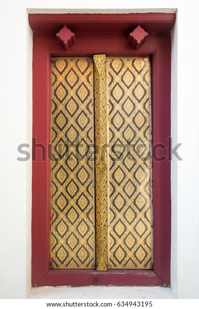 Gold window Red frame form Wat Phra Si Rattana Mahathat (Public places) in  thailand