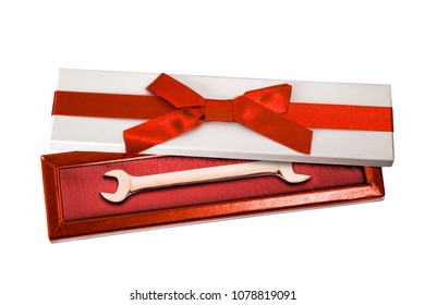Gold wrench for nuts in a gift box. 3D illustration