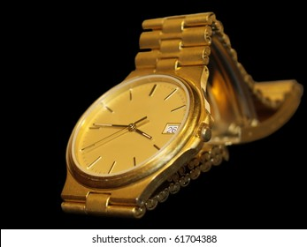 gold wrist watch isolated on black background