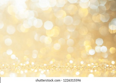 Gold, yellow abstract light background, Pink Gold  bokeh shining lights, sparkling glittering Christmas lights.Season greeting background.New year Luxury backdrop image.Blurred abstract background.