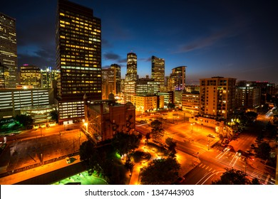 gold yellow city lights glowing nightscape in downtown Denver Colorado skyline cityscape the mile high capital city