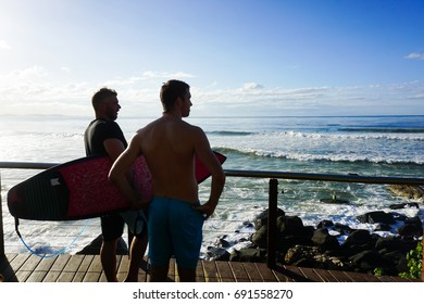GOLDCOAST, AUSTRALIA - JUNE: Two men with surfboard looking to sea at Goldcoast on june, 2015, Queensland, Australia