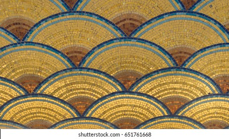 Gold-colored mosaic in arches with blue and brown