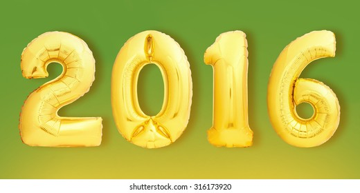 Golden 2016 Christmas sign made of inflatable balloons on green background.