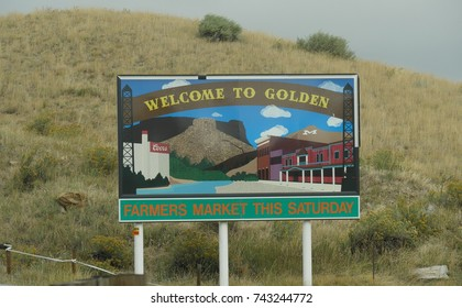 GOLDEN, COLORADO—OCTOBER 2017: Colorful welcome sign approaching Golden, Colorado, with information about a farmer's market activity.