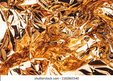 Golden abstract background made of wrinkled golden paper