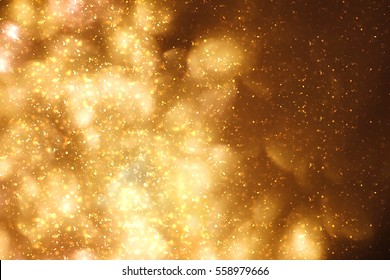 Golden abstract sparkles or glitter lights. Festive gold background.defocused circles bokeh or particles. Valentines day template