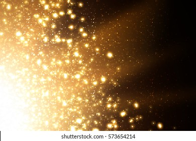 Golden abstract sparkles or glitter lights. Festive gold background. Defocused circles bokeh or particles. Template for design.