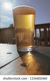 Golden ale in glass on table outdoors