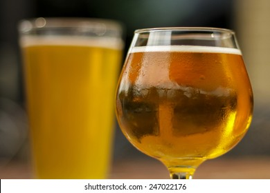 Golden Ale in Pint Glass and Snifter