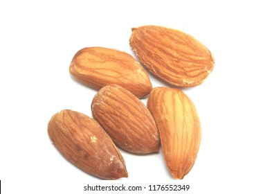 Golden almonds over white