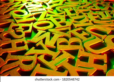 Golden alphabet letters. Volumetric gilded letters. Alphabet is in a chaotic state. Letters as a symbol of reading. Reading English literature. Reading training. Concept - writing and selling books