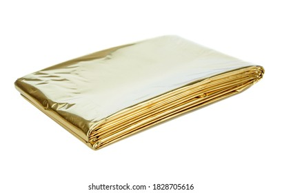 A golden aluminium foil emergency first aid kit heat sheet on a white background