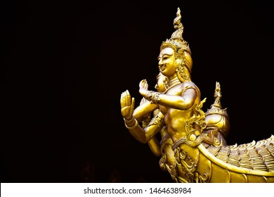 Golden angel naga statue with back background at Wat Sri Pan Ton. An angel naga sculpture in Sri Pan Ton temple. An ancient temple Lanna style architecture in Nan province, north of Thailand.