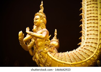 Golden angel naga statue at Wat Sri Pan Ton. An angel naga sculpture in Sri Pan Ton temple. An ancient temple Lanna style architecture. One of the most famous place in Nan province, north of Thailand.