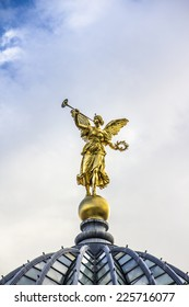 The Golden Angel on top of the glass dome of the Acadamy in the historic city of Dresden, Germany.
