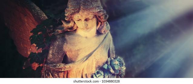 golden angel in the sunlight (antique statue)