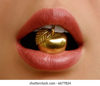 golden apple in a mouth