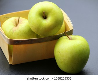 golden apples in small wooden containers