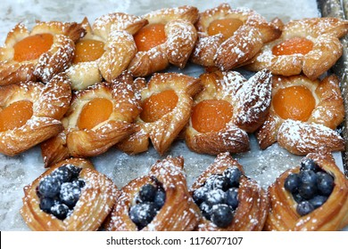 Golden apricot and blueberries puff pastries