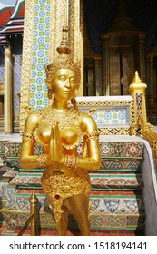 The golden Apsarasi statue at Wat Phra Kaew or the temple of the Emerald Buddha located within the grounds of the Grand Palace in Bangkok,Thailand