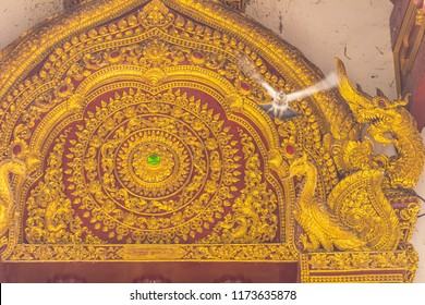 Golden arched Lanna style patterned Buddhist church at Wat Phra Singh,Temple of the Lion Buddha. Wat Phra Singh is an important Buddhist monastery and temple on the west side of Chiang Mai, Thailand.