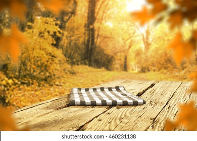 golden background of fall and blue napkin place
