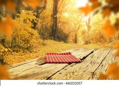 golden background of fall and red napkin on table place