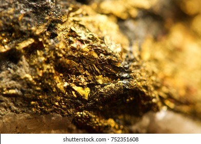 Golden background. Gold natural mineral. Macro photo of the precious stone