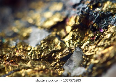 Golden background. Gold nugget. Backdrop for the project. Macro