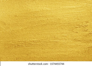 Golden background. Metallic yellow color painted rough surface texture