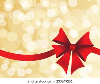 Golden background with a white bokeh and red bow