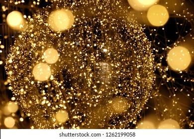 Golden ball lighting blur background, christmas lights.