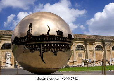 Golden ball in Vatican over blue sky