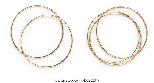 Golden bangles arranged. Isolated object on white background.