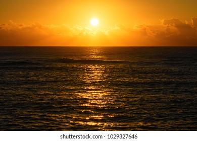 Golden beach sunrise or sunset over the sea