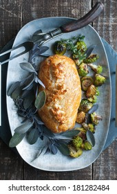 Golden Beef Wellington with purple sage and roasted vegetables