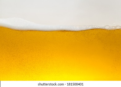 Golden Beer alcohol wave with foam and bubbles