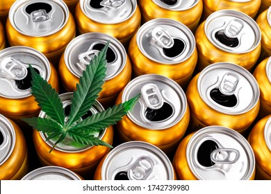 Golden beer cans.The sale of products and drinks with addition of hemp (cannabis) Beer cans with weed on one of them