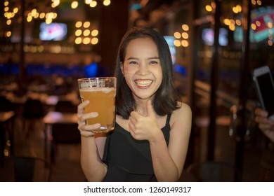 Golden Beer in a Glass Stein for Oktoberfest. Pint of Draft Wheat Beers in Friendship Bachelorette Parties at Bar. Young Girls Night Life Concept.