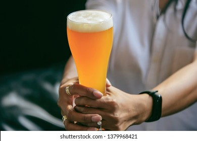 Golden Beer in a Glass Stein for Oktoberfest. Pint of Draft Wheat Beers in Friendship Bachelorette Parties at Bar. Young people Night Life Concept.