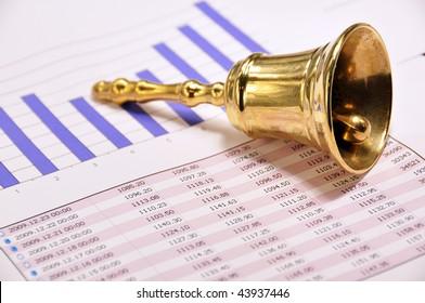 Golden bell on a market report
