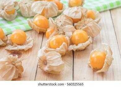 Golden berries or physalis fruit on wooden table