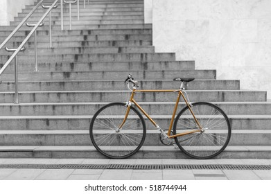 golden bicycle on stairs