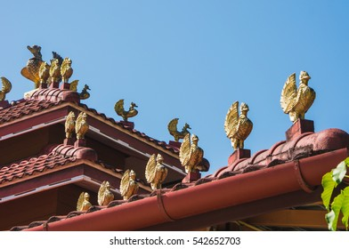 Golden bird statue on the red roof
