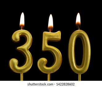 golden birthday candles on black background, number 350